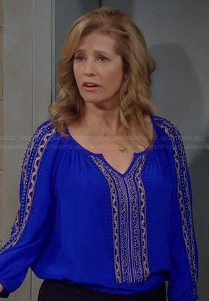 Vanessa's blue embroidered peasant blouse on Last Man Standing