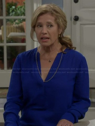 Vanessa's blue long sleeved v-neck blouse on Last Man Standing
