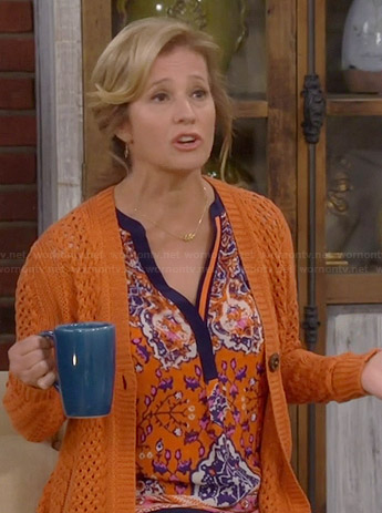 Vanessa's orange printed blouse and crochet cardigan on Last Man Standing
