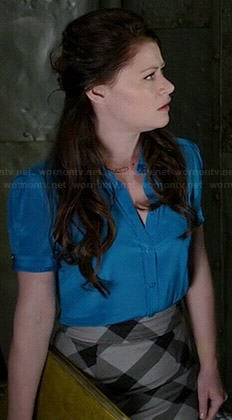 Belle's blue short sleeved top and checked skirt on Once Upon a Time