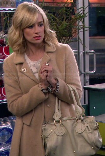 Caroline's beige furry coat on 2 Broke Girls