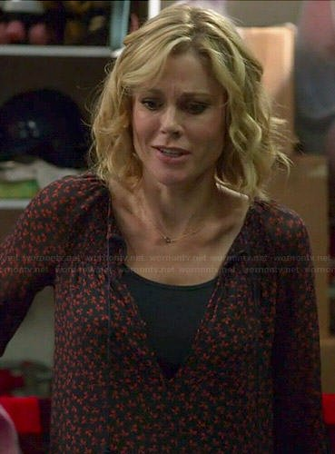 Claire's red and navy printed blouse on Modern Family
