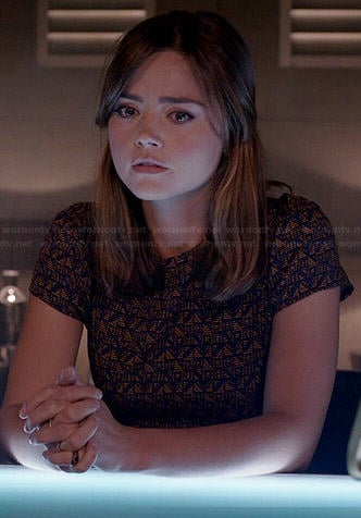 Clara's orange and navy geometric patterned dress on Doctor Who