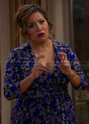 Cristela's blue star print wrap dress on Cristela