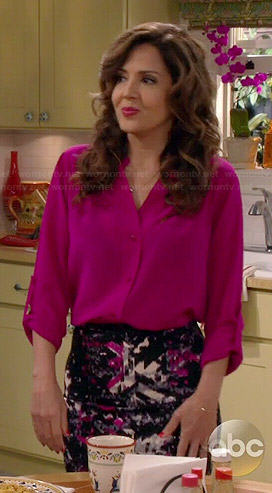 Daniela's pink rolled sleeve blouse and printed pencil skirt on Cristela