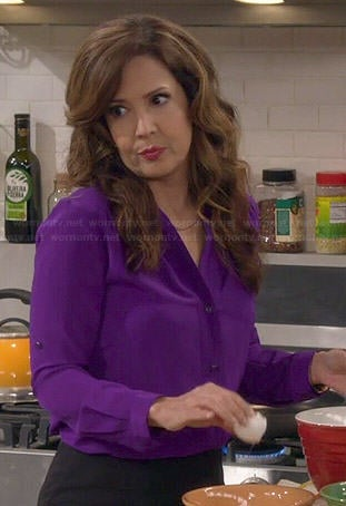 Daniela's purple v-neck button front blouse on Cristela