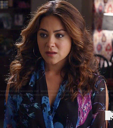 Elena's black, pink and blue floral wrap blouse on Happyland