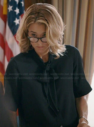 Elizabeth's black short sleeved neck tie blouse on Madam Secretary