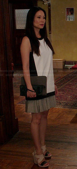 Joan's black and white colorblock top and two-tone wedges on Elementary