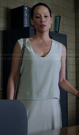 Joan's grey v-neck layered dress on Elementary