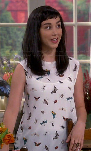 Mandy's white butterfly and bug print top on Last Man Standing