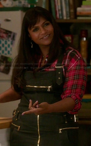 Mindy's red plaid shirt and black denim overall dress on The Mindy Project