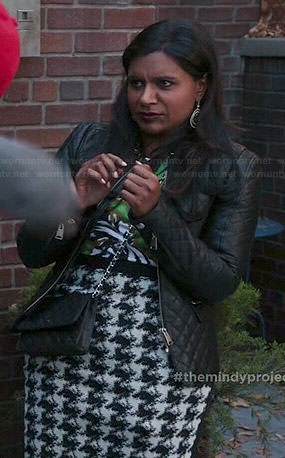 Mindy's green floral top, houndstooth skirt and quilted leather jacket on The Mindy Project