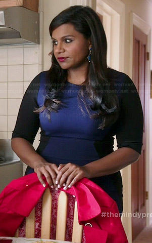 Mindy's navy blue dress with black sleeves and side panels on The Mindy Project