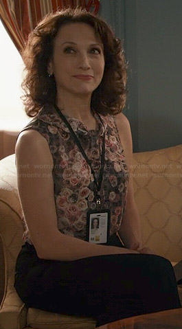 Nadine's sleeveless rose print blouse on Madam Secretary