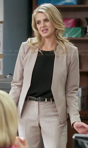 Nina's beige pant suit on Benched