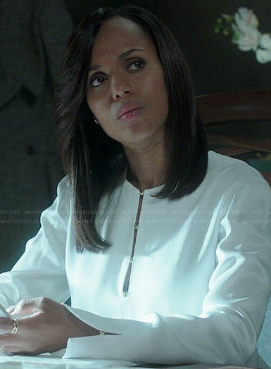 Olivia's white long sleeved blouse with gold buttons on Scandal