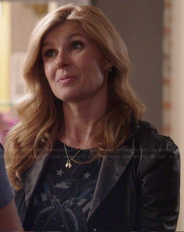 Rayna's black star graphic tee and leather jacket on Nashville
