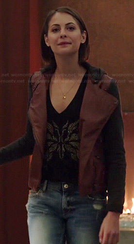 Thea's burgundy leather jacket with black sleeves and hood on Arrow