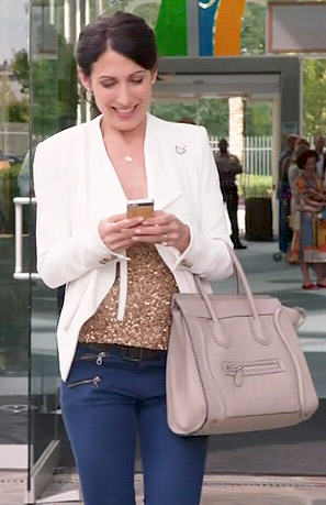 Abby's white draped jacket, sequinned top and jeans on Girlfriends Guide to Divorce
