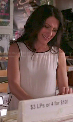 Abby's white layered top with black trim on Girlfriends Guide to Divorce