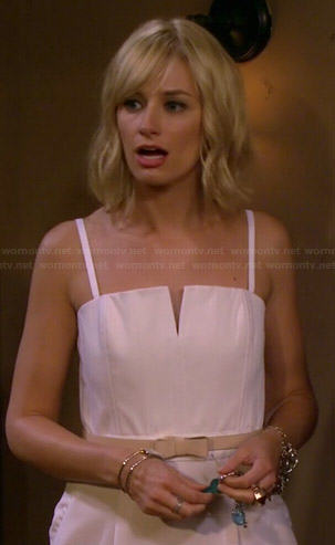 Caroline's beige split neck top on 2 Broke Girls