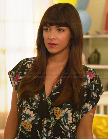 Cece's black floral jumpsuit on New Girl