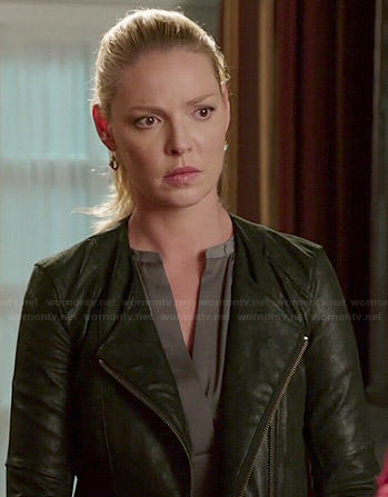 Charlie's grey split neck blouse and leather jacket on State of Affairs
