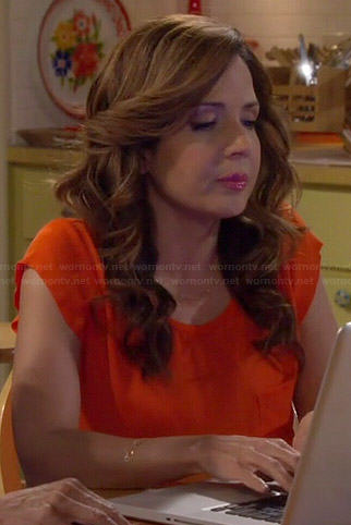 Daniela's orange top on Cristela