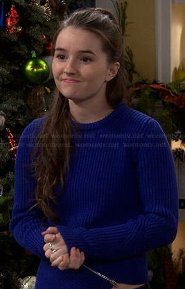 Eve's blue asymmetric zip sweater on Last Man Standing