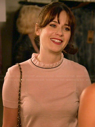 Jess's light pink ruffled neck sweater on New Girl