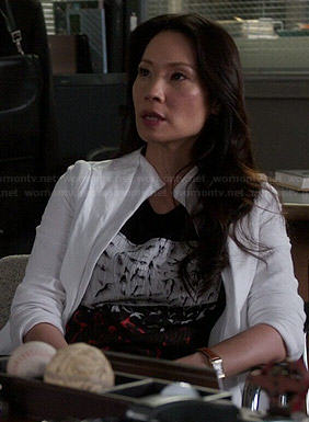 Joan's black, white and red bird print top on Elementary