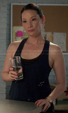 Joan's blue diagonal striped tank top on Elementary
