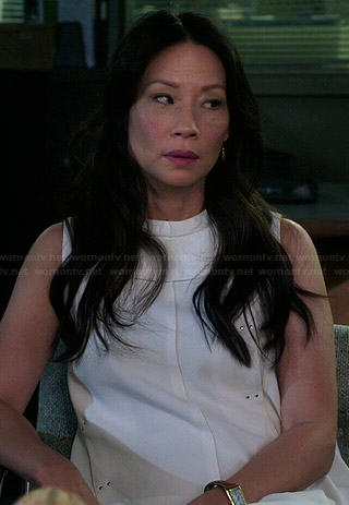 Joan's white studded panelled dress on Elementary