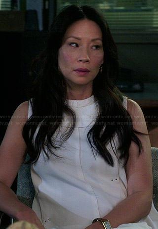 Joan's white studded panelled dress on Elementary