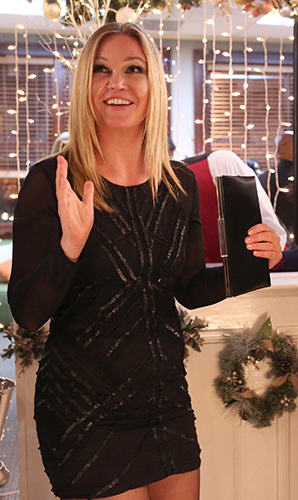 Jessica (Julia Stiles)'s black long sleeved sequin mini dress on The Mindy Project