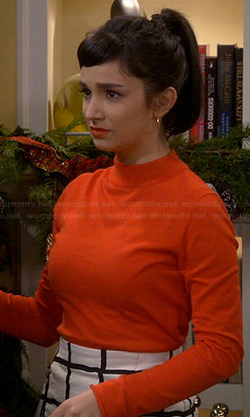 Mandy's orange mock neck sweater and grid checked skirt on Last Man Standing