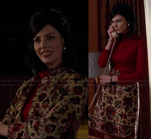 Megan's patterned coat and skirt with red high neck top on Mad Men