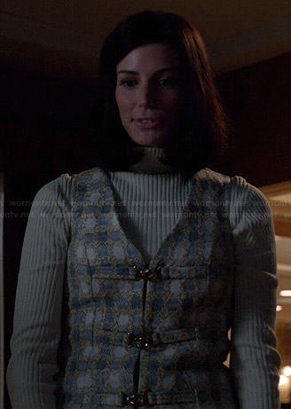 Megan's polka dot buckle-front dress and ribbed turtleneck on Mad Men