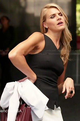 Nina's black asymmetric v-neck peplum top and white skirt on Benched