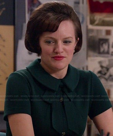 Peggy's green button front dress with tie neck on Mad Men