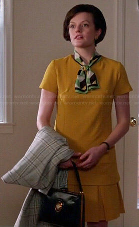 Peggy's yellow top and pleated skirt set on Mad Men