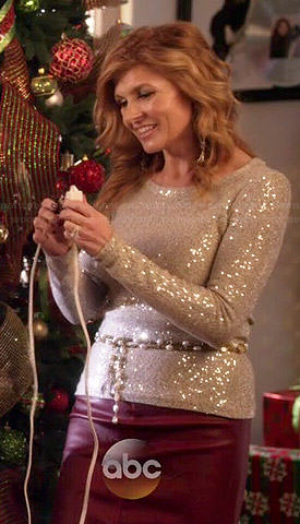 Rayna's sequinned sweater and burgundy leather skirt on Nashville