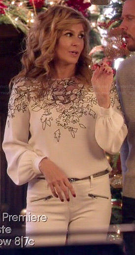 Rayna's white long sleeve floral embroidered blouse on Nashville
