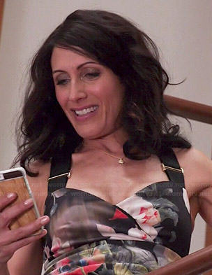 Abby's floral dress with black straps on Girlfriends Guide to Divorce