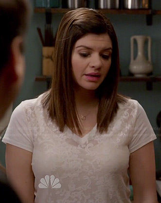 Annie's white v-neck lace tee on Marry Me