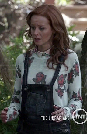 Cassandra's rose print sweater and denim shortalls on The Librarians