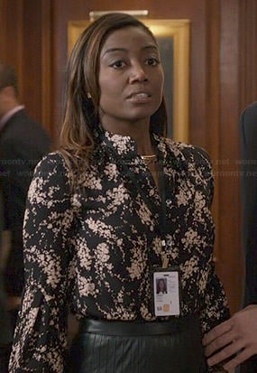 Daisy's black and white floral top and pleated leather skirt on Madam Secretary