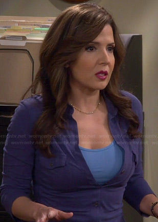 Daniela's blue button down top on Cristela