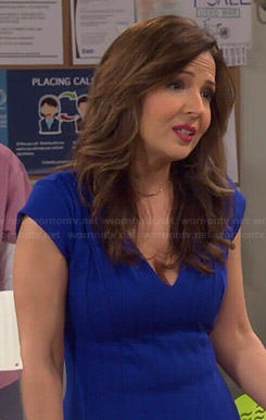 Daniela's blue pleated v-neck dress on Cristela